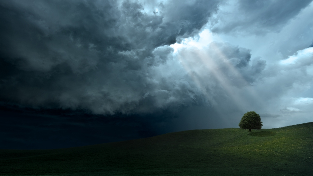 sunlight-through-dark-clouds-wallpaper-2